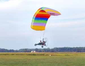 Powered Parachute, Paraplane, Motorized Parachute, PPC for Sale. Powered  Parachute information, products, manuals, flying lessons, Plans, and more.  Powered Parachute Flying Handbook. Find at:  http://www.goldmedal100.com/ppc.htm