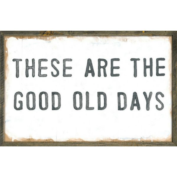 """This simple art print features a white background with the phrase, """"These are the good old days"""" printed in a dark font. Available in 2 sizes: 2' x 3' & 3' x 4'"""