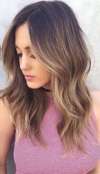 Hair is on point. We are all about the light brunette hair coloring with a light wave!
