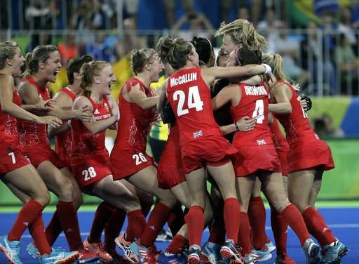 Britain tops Netherlands, wins 1st women's field hockey gold:  August 19, 2016  -    Britain players celebrate after they beat Netherlands in the penalty shootout, during a women's field hockey gold medal match at 2016 Summer Olympics in Rio de Janeiro, Brazil, Friday, Aug. 19, 2016. (AP Photo/Hussein Malla)