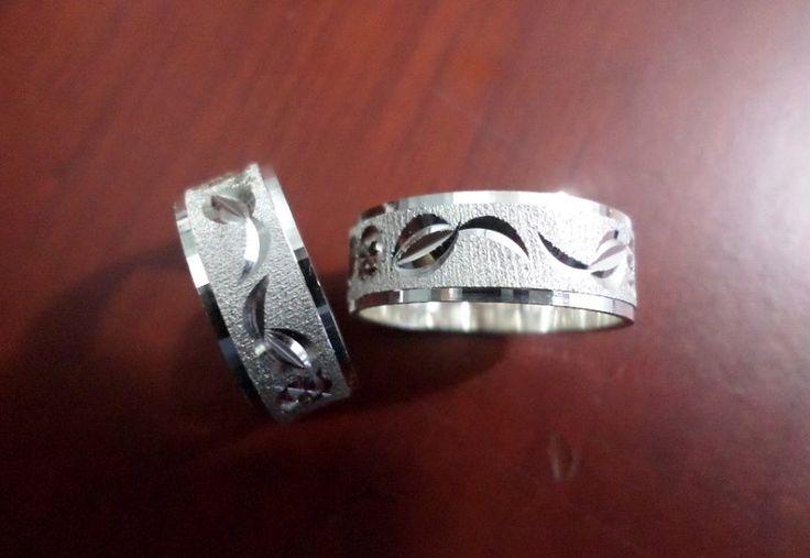Argollas de matrimonio Plata ley 950 con diamantado de hojas
