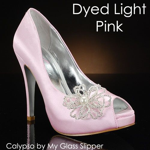 Oh so pretty pink wedding shoes.  See more pink wedding ideas: http://www.squidoo.com/pink-and-black-weddings