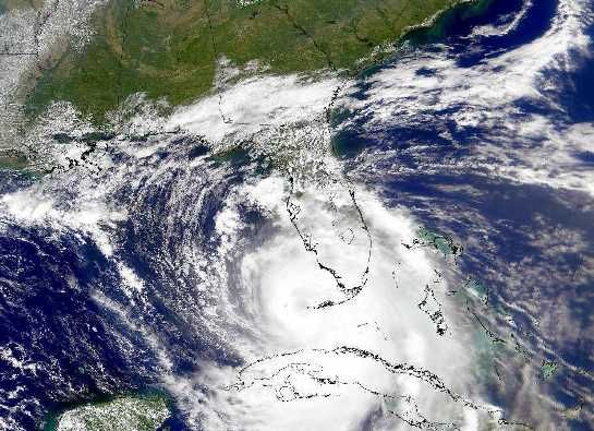A Hurricane in the Gulf (Sept 28 1998) IMAGE CREDIT: SeaWiFS Satellite, NASA Last Friday, Hurricane Georges was photographed from space entering the Gulf of Mexico. Immense storm system, larger than most states.  Starting as a slight pressure difference, hurricanes grow into large spiraling storm systems of low pressure, complete with high winds and driving rain.