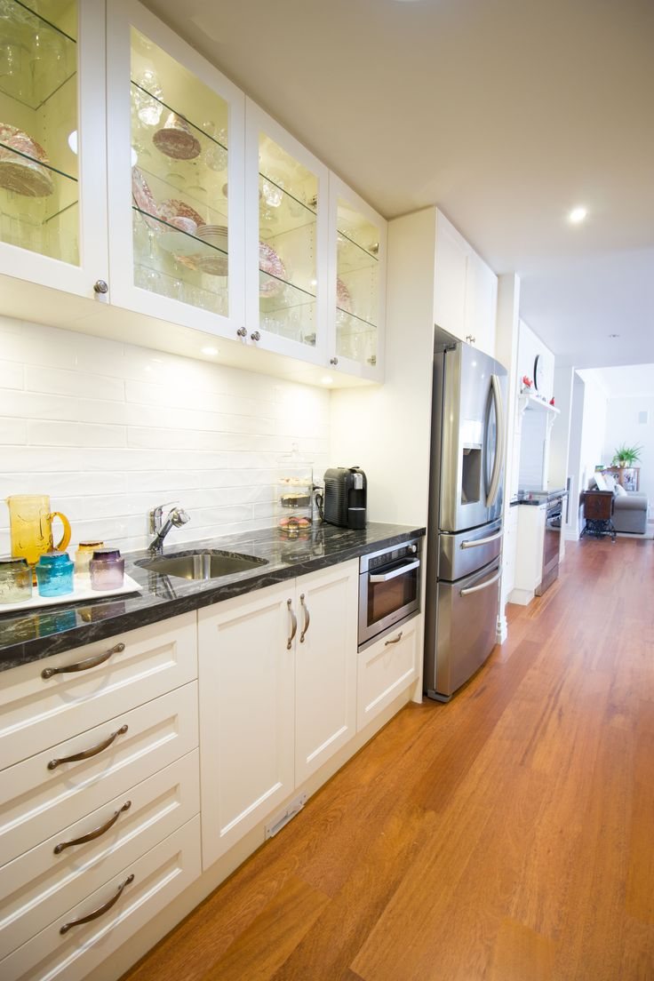 Walk through pantry. Traditional kitchen. Glass cabinets www.thekitchendesigncentre.com.au