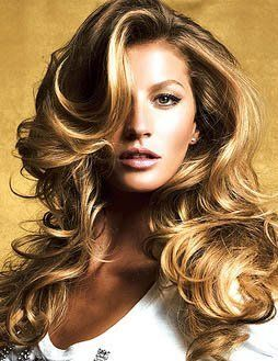 Beautiful long layers on a soft, natural-looking blond. No fake-looking hi- lites here. Round brush dried and/ or large roller set.