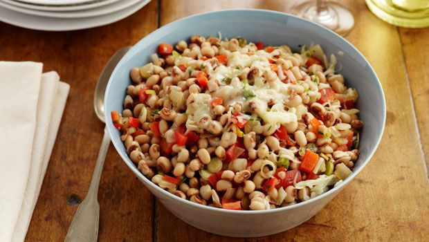 "Katie Lee's Hoppin' John: ""Growing up in West Virginia, none of us were big party animals on New Year's Eve. My mom, grandparents, extended family, and a friend or two would just try our best to stay up and watch the ball drop on TV. The next day we'd have a New Year's Day supper, and that's when Mom would make Hoppin' John with greens and cornbread."""