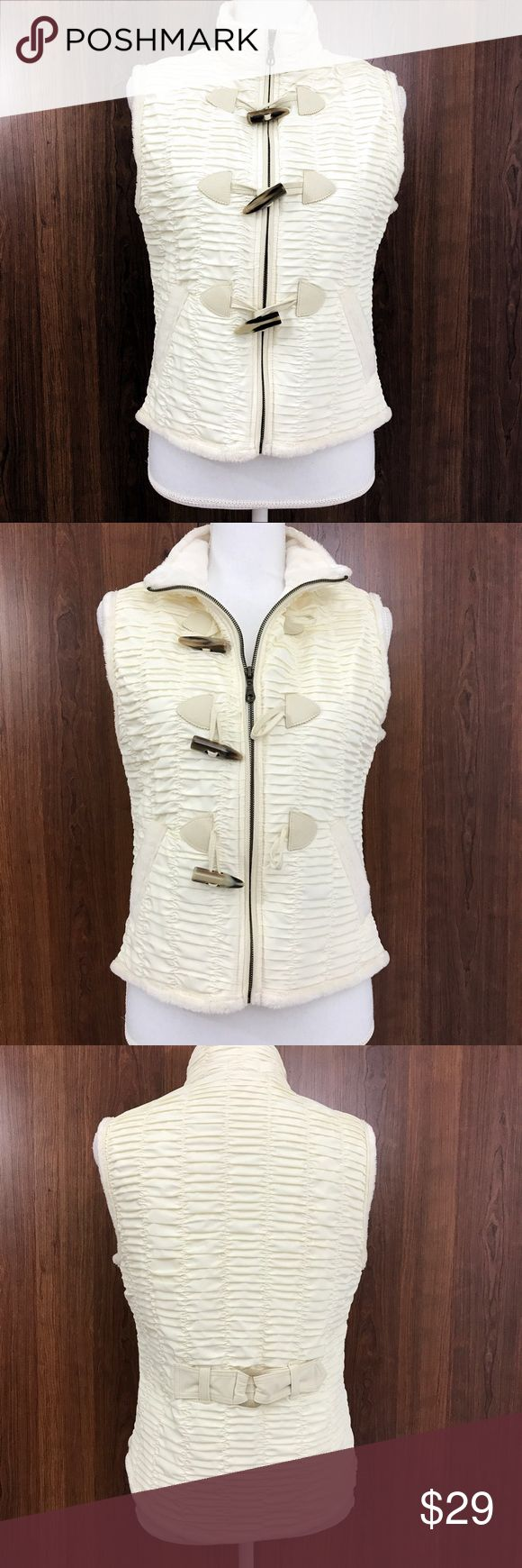 """Baxis & Baxis Cream Vest. Medium A beautiful and elegant women's vest designed by Baxis & Baxis. Fleece lined for warmth. Hi- Lo Length. Marble-look on """"ivory"""" smooth buttons. Zip up closure. A cute accent on the back waist for a nice figure flattering fit. Pre-owned. Great condition. Dry clean. Medium. Baxis & Baxis Jackets & Coats Vests"""