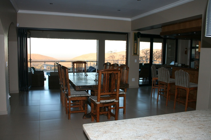 Dining room thru to bar, patio and pool. Stacking doors open up the room to the outdoors