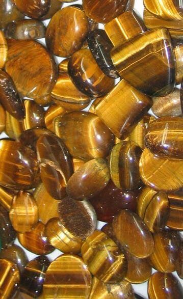 """TIGER EYE   """"Tiger Eye brings in the energy from the sun to combine it with the earth's to enhance psychic abilities. This grounding stone aids in organizing otherwise spacey thought patterns."""" Source: The Ancient Sage"""