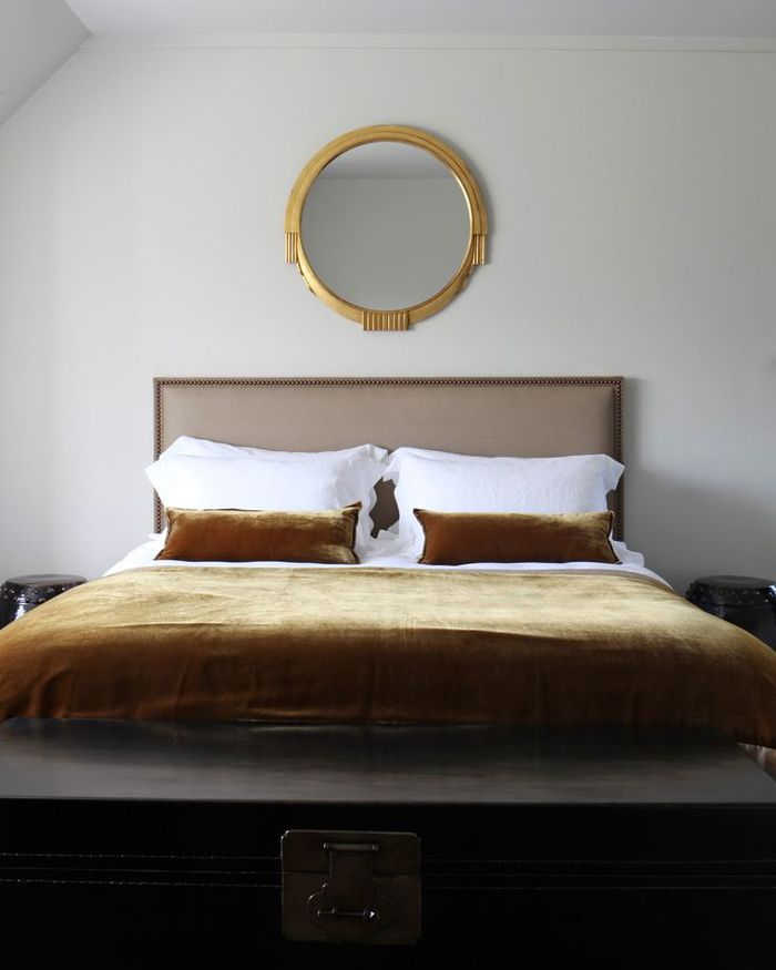 Art deco luxe goes minimal in this lovely little bedroom by John Minshaw Designs. Photo by James McDonald.