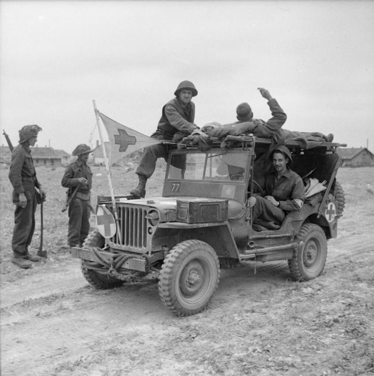 Casualties being brought in by a Canadian jeep to a regimental aid post nearVaucelles, 19 July 1944.