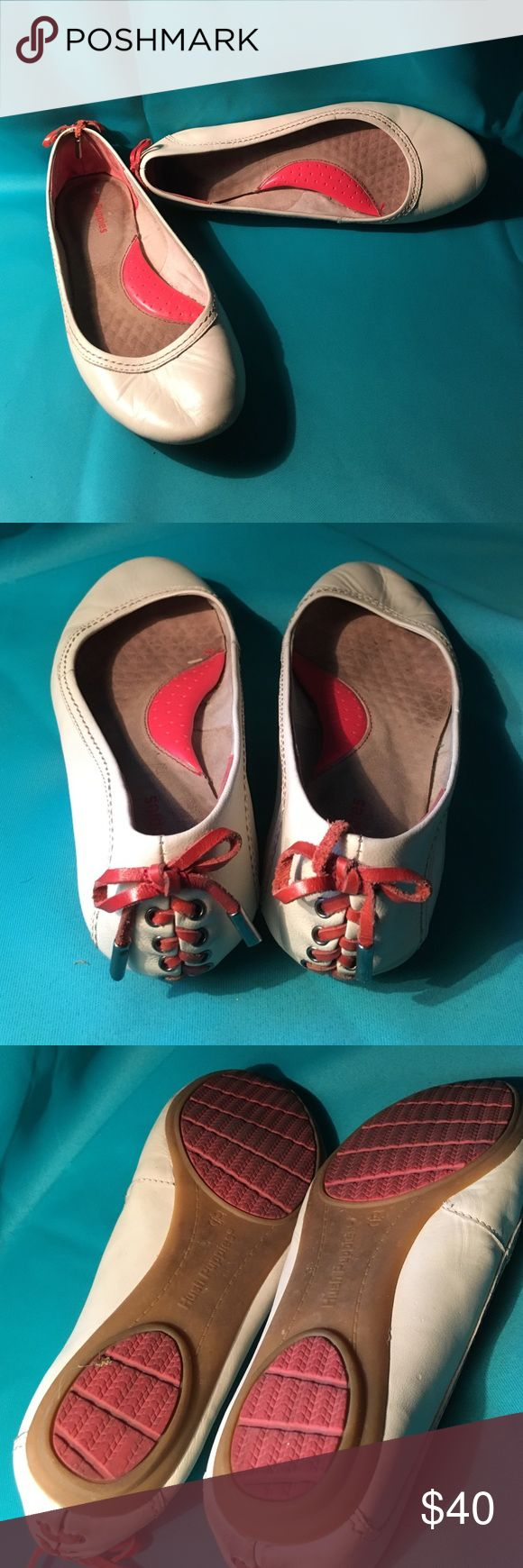 Looking for cute and comfortable??? Hush puppies cream flats with a melon detail down the back. Gently worn with the only signs of wear on vida le on the bottom of the shoes.  Great condition. Hush Puppies Shoes Flats & Loafers