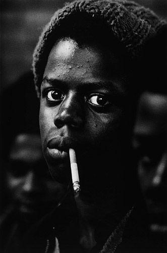 Don McCullin,Boy smoking a cigarette, Bradford, 1973.