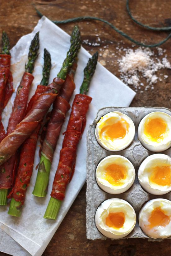 Sunday brunch inspiration: soft-boiled eggs with prosciutto-wrapped asparagus.