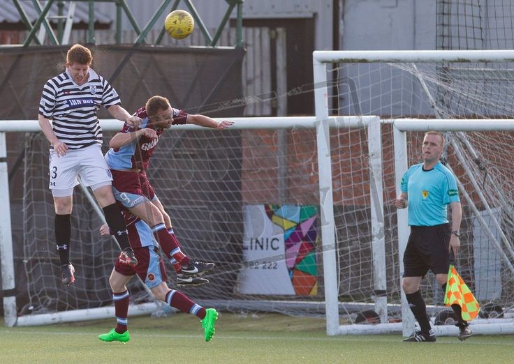 Queen's Park's Scott Gibson heads the ball clear during the Betfred Cup game between Stenhousemuir and Queen's Park.
