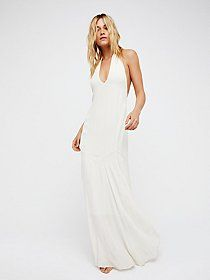 Lille Maxi Dress | Made with our sheer and gauzy Endless Summer fabric, this flowy and effortless maxi dress featuring a halter neckline with adjustable ties at the back creating skin baring cutout details. Layered design with dramatic slits.  * Bell accents on ties * Adjustable drawstring at the waist for the perfect fit