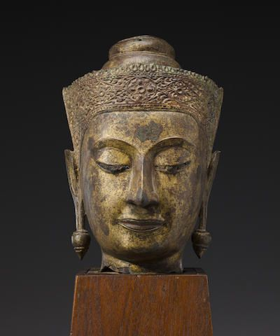 A gilt copper alloy head of Buddha Thailand, Ayutthaya period, Late Sukhothai style, 16th/17th century
