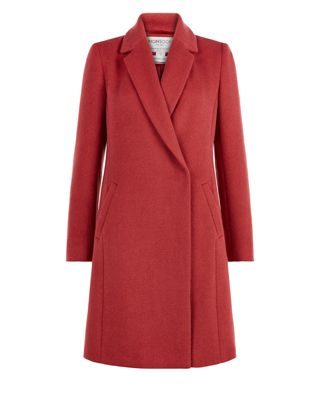 Our Hettie wool-blend coat is designed with a flattering, slim-fit silhouette, and has a smooth lining so it layers easily over both smart and off-duty looks...