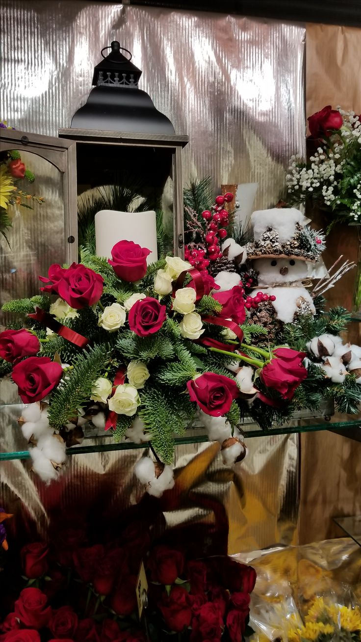 53 best flowers from buehlers floral department images on pinterest red and green bring christmas cheer this floral arrangement is created by the designers in izmirmasajfo