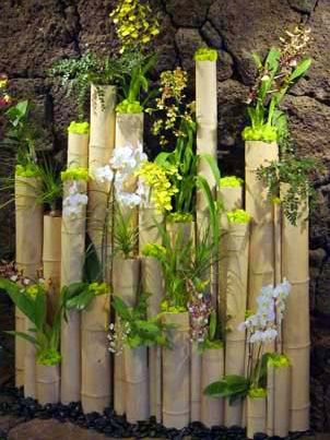 Reclaimed Bamboo Logs Adorned with White Phalenopsis Orchid Plats, Oncidium Orchids and Wild Cats. Created by MartinRoberts Design