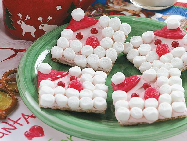Santa Grahams red gel food color 1 1/4 cups vanilla frosting (from 16-oz. can) 12 (2 1/2-inch-square) graham crackers 1 cup (about 75) miniature marshmallows, halved crosswise 6 small red gumdrops, halved crosswise 24 Betty Crocker® red cinnamon decors