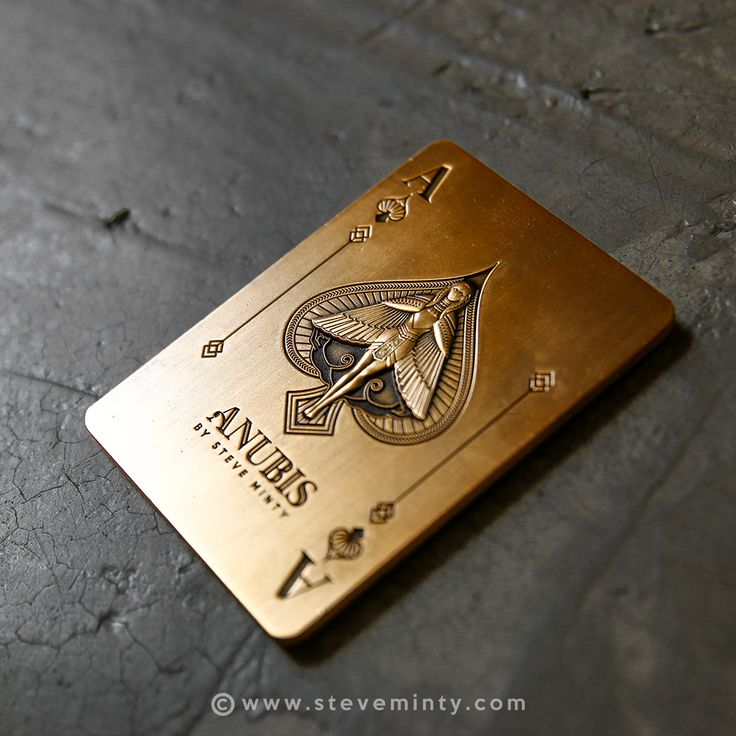 "This Antique Gold Card features the Anubis Ace of Spade and card design of the Anubis Playing Cards. Goes perfect with the collection! Product Details: - 2.5""x3.5"" - Antique gold finish - 3-d details"