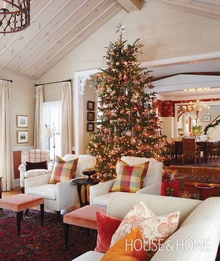 Loaded with ornaments, both old and new, the 12-foot tree stands between the dining room and living room, allowing it to be seen from many vantage points.