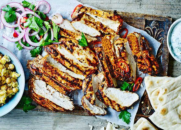 Marinated in lemon juice and delicious spices, this chicken is cooked on a hot griddle pan and served with smashed chickpeas and a roasted red onion salad