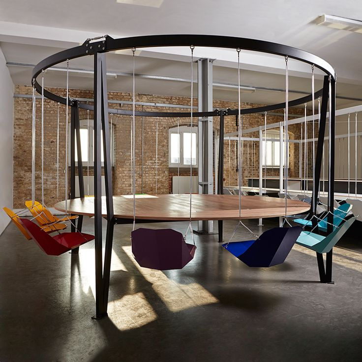 The King Arthur Round Swing Table, bring the playground into the boardroom or dining room, make meetings or dinners fun and inspiring experiences. By Duffy London