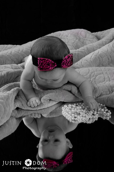 Beautiful baby with pearls! Mirror with black back drop