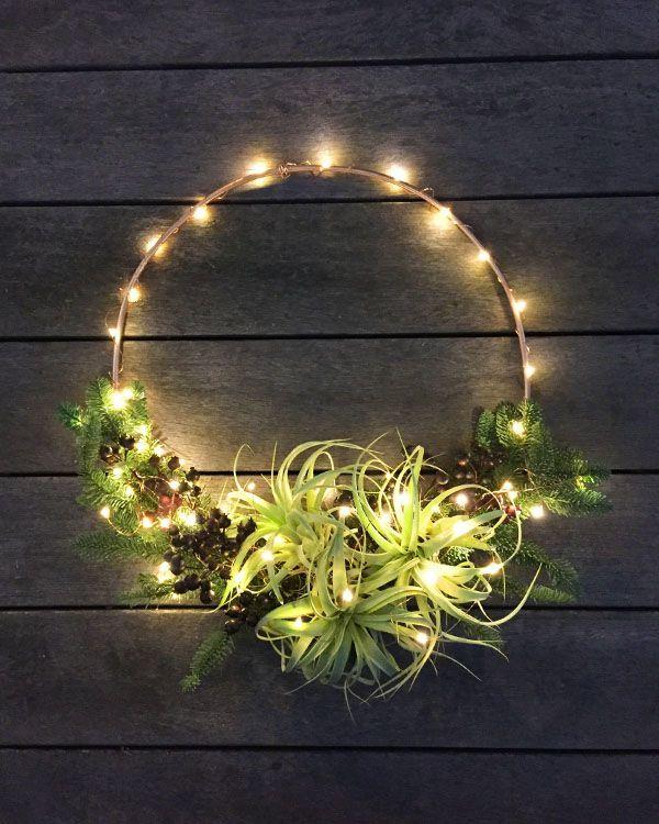Modern airplant, evergreen, and copper tubing wreath from FARMandFOUNDRY.com #farmandfoundryfestive