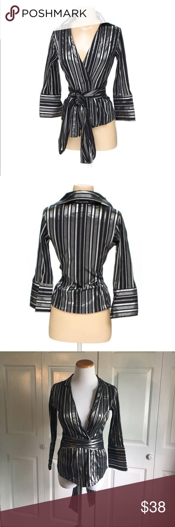 ZARA Wrap Around Tie Blouse Black and metallic silver Blouse with long, adjustable wrap-around tie. Bow can be worn long or short, in the back or in the front. 3/4 sleeve. Excellent condition, no flaws. Zara Tops Blouses