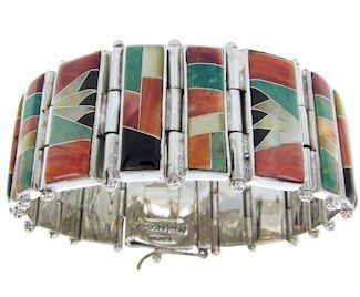 """Multicolor And Sterling Silver Whiterock Sunset Link Bracelet YS69829 SilverTribe. $839.99. Multicolor And Sterling Silver Whiterock Sunset Link Bracelet YS69829. MATERIALS: WhiteRock Sunset Jewelry Theme* (See description below).. Southwestern Jewelry. MEASUREMENTS: The link bracelet measures approximately 7-3/4"""" inside circumference, which means the bracelet will fit a wrist that is 6-3/4"""" to 7-1/2"""" comfortably. The larger links measure approximately 3/8"""" at widest poi..."""