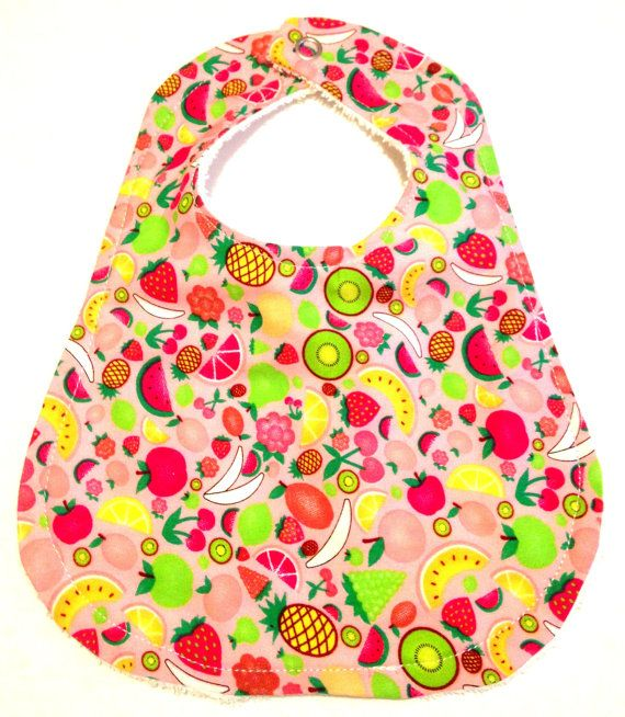 Welcome to LJs Dub Shack  Your little one will look adorable in this very cool handmade bib.  Using bright colours and retro designs, we make baby