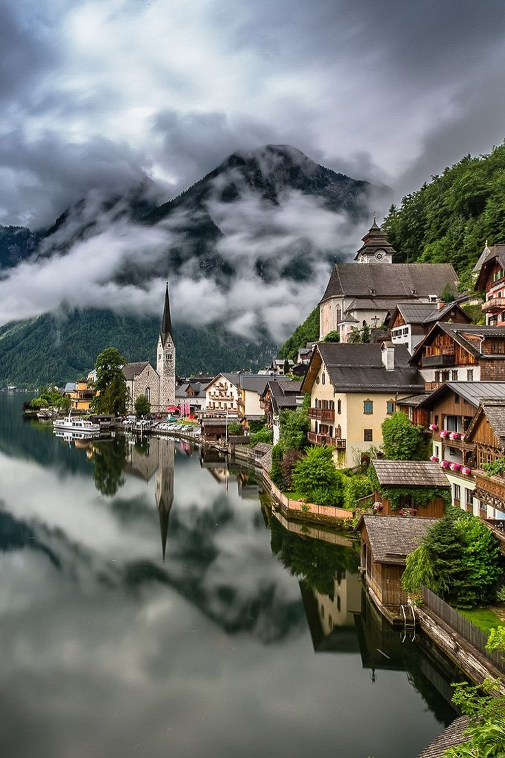 Hallstätt - Nestled between the edge of Hallstätter See and the towering Dachstein mountains, Austria's oldest village is something like a mirage in the Salzkammergut Lake Region.