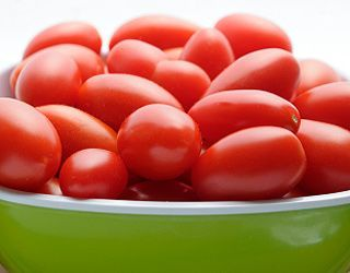 Grape Tomatoes   One cup of grape tomatoes clocks in at only 30 calories. These bite-sized nibbles are sweet, colorful, and ideal for snacking since you can pop 'em in your mouth one at a time. And, because they're so low in calories, you can munch to your heart's content!