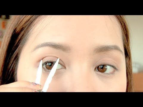 How to even out your eyelids | Michelle Phan ... This landed in my inbox this morning and I used to see eye-lid tape being sold in Japan a lot and it fascinated me.  I always wondered how it was used.