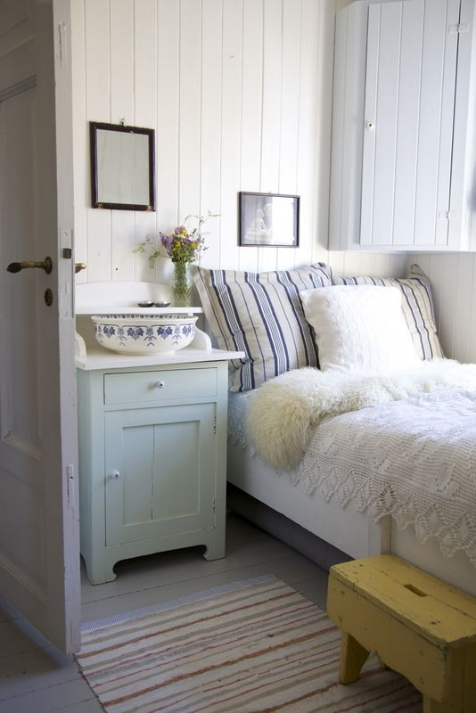 bright bedroom with blues and white