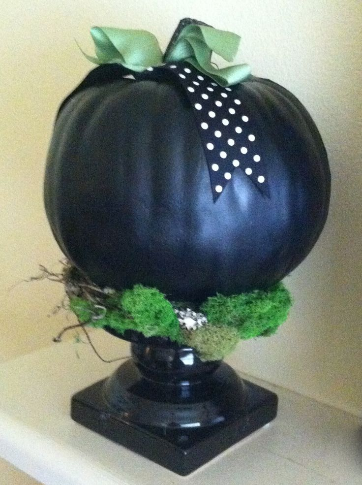 Polka dots and pumpkins, cute combination.  I made these by painting some pumpkins black, and glueing them to a black ceramic candlestick with some moss and branches.  Very simple project.