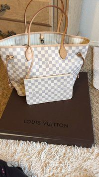 Louis Vuitton Neverfull Mm Damier Azur Shoulder Bag. Get one of the hottest styles of the season! The Louis Vuitton Neverfull Mm Damier Azur Shoulder Bag is a top 10 member favorite on Tradesy. Save on yours before they're sold out!