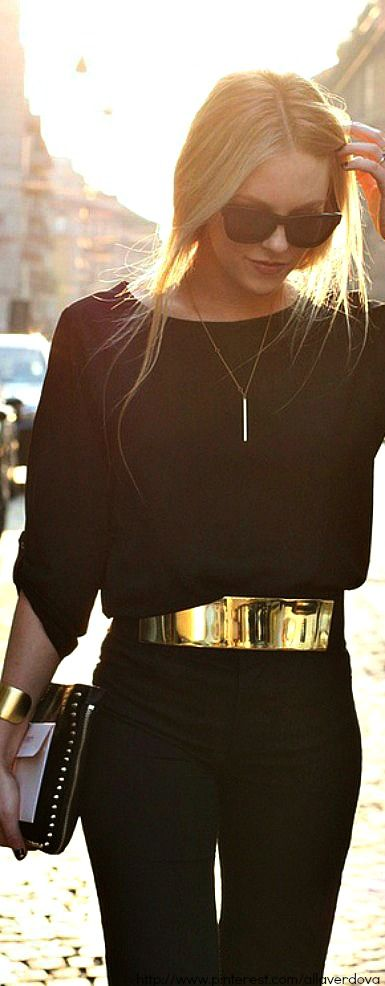 All black outfit with gold accessories.