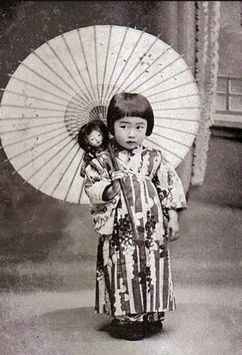 Japanese child, 1920. (Can we just take a moment to notice how creepy that doll is?!)