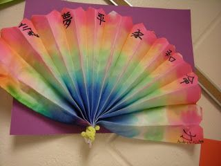 Fold 'dippity-dye' paper into fans, color with washable markers, dip quickly in water, & let dry