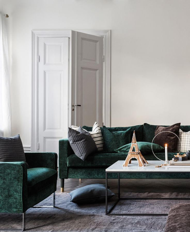 Minimal Scandinavian holiday decor | For those who really want to up their holiday decor ante, give your IKEA sofa a complete Christmas makeover with a festive slipcover | IKEA Karlstad sofa with a Bemz cover in Designers Guild velvet | velvet sofa