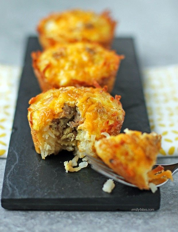 These Sausage Egg and Cheese Hash Brown Cups are all your favorite breakfast foods in a portion controlled cup! Easy and delicious for just 123 calories or 4 Weight Watchers SmartPoints. www.emilybites.com