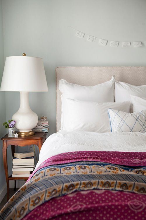 white bedding + global inspired textiles