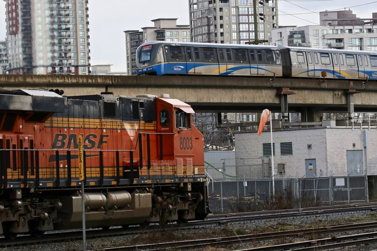 SkyTrain passes BNSF 8003 in New Westminster, B.C. Click image to enlarge.