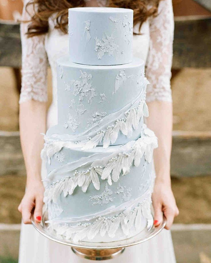 Wedding Cake Design Ideas That'll Wow Your Guests   Martha Stewart Weddings - For this ice-blue beauty, the design is in the feather details. All three layers of this wedding cake feature soft blue fondant and textured accents. #weddingcakes #weddingideas