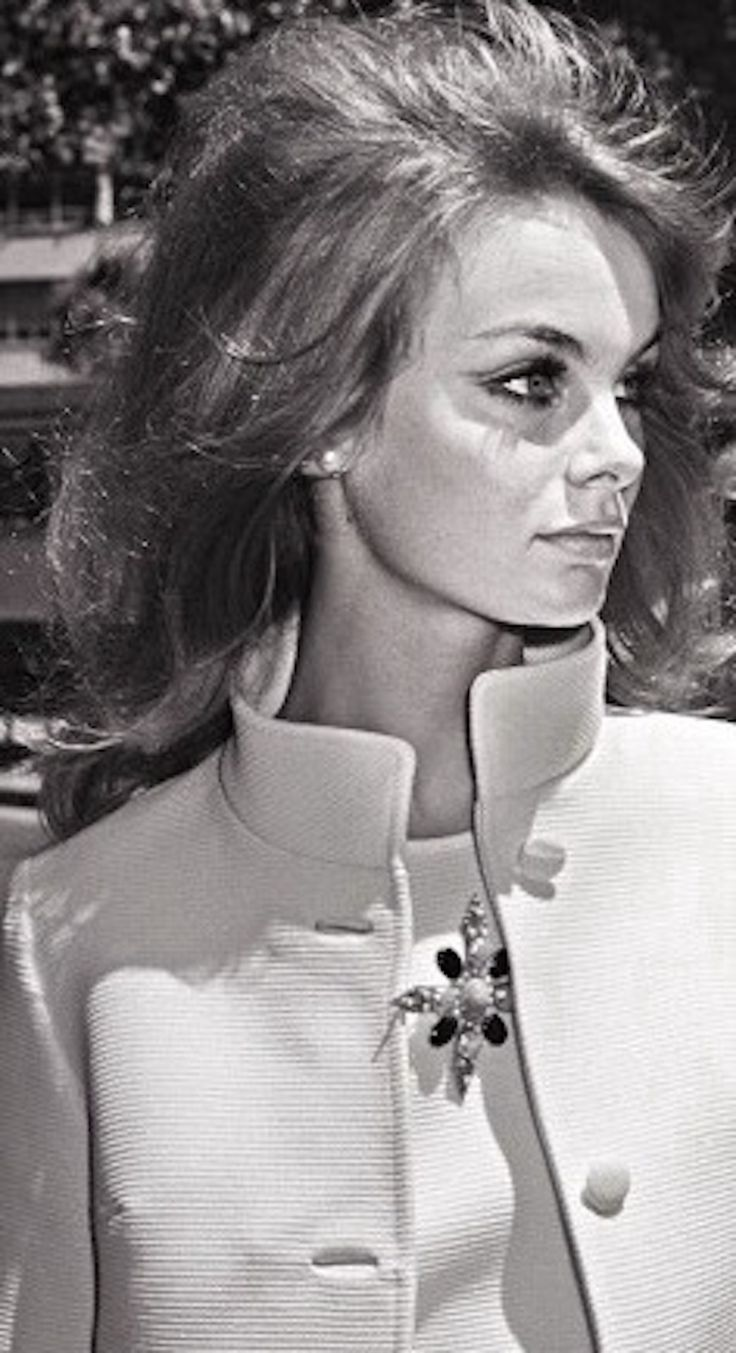 "1965: Jean Shrimpton at the 1965 Melbourne Cup where she sparked off a scandal with her minidress (designed by Colin Rolfe). Not only was it five inches above her knees, she further scandalised Australians by not wearing stockings (nor gloves). 'I was surrounded by cameramen, all on their knees like proposing Victorian swains, shooting upwards to make my skirt look even shorter. I had no idea this was going to happen - this was publicity that I had certainly not planned."" KA"