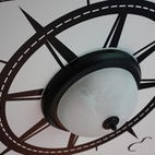 """hmmm, use the """"nautical star"""" to create a large clock above mantel???"""
